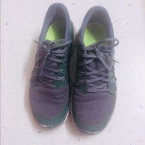 Army green Nike sneakers